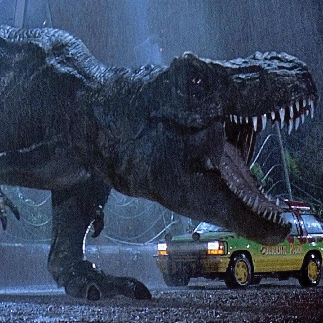 Film still of a tyrannosaurus roaring from the film Jurassic Park